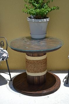 My dad had this idea back in the 80s. We had a large spindle for a deck table and smaller ones like this for chairs!