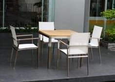 The Caspian 4 seater bistro style set is modern with a designer feel. This set is great for a roof garden or decking area.  The table has a solid premium teak top with grade 304 stainless steel legs and frame. Includes 4 very high quality Batyline® weather proof sling, premium teak and stainless steel stacking armchairs which are available in a choice of white, black and cappuccino coloured sling.