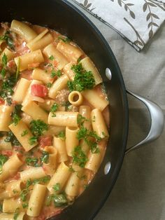 One Pot Cheesy Sausage Pasta is an easy to make one pot meal that is creamy and full of flavor. This dish comes together in under 30 minutes and is sure to be a hit with your family.// A Cedar Spoon
