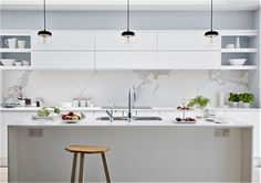 Pure handleless kitchen from John Lewis of Hungerford, shown here in Pure White with white quartz worktops and Neolith marble-look splashback. http://www.john-lewis.co.uk/kitchens/contemporary-pure-kitchen