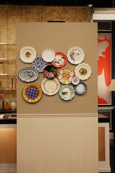 hang and layer favorite plates on wall.