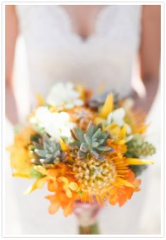 Orange floral and succulent bouquet by http://bellabloomsfloral.com