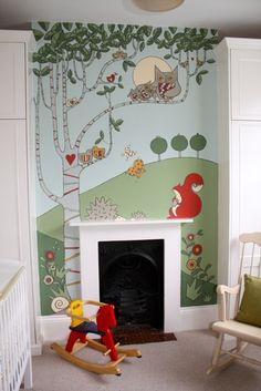Hand painted nursery mural with a woodland theme by artist and illustrator Adam Regester