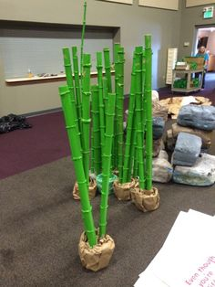 OTHER IDEAS OF HOW TO SET CROPS. We borrowed these bamboo, which were part of our main stage. These were made from hard cardboard tubes mounted in cement-filled ice cream tubs. Deco Pirate, Submerged Vbs, Fake Trees, Panda Party, Vbs 2016, Vbs Crafts, Paper Tree, Cardboard Tubes, Vacation Bible School