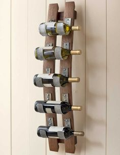 A rustic five bottle wine storage rack that is handcrafted from two genuine reclaimed wooden wine barrel staves and uses the metal barrel rings to securely hold the bottles horizontally. Wine Glass Rack, Wood Wine Racks, Wine Rack Wall, Iron Wine Rack, Wine Barrel Crafts, Wine Barrel Rings, Wine Barrels, Wine Cellar, Wine Barrel Wall