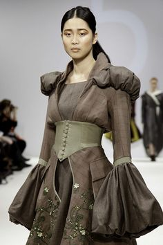 Modern example of The late middle ages. Chemise-like with puffy arms and shoulders.