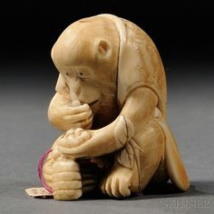 Ivory Netsuke of a Monkey, Japan, 19th/20th century, seated eating fruit, dressed in a half-sleeved robe, ht. 1 3/4 in.