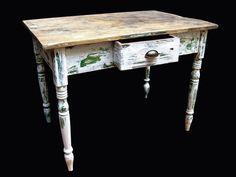 Mesa de madera maciza, encerada. Antigua, restaurada de 1m.x 0,68m.x 0,77m. de altura. La tapa lavada y la base decapé. Cajón con tirador antiguo