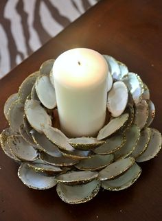 See, how beautiful is this DIY seashell candle holder. This awesome candle holder is simply created from clam shells left from seafood lunch. It's a great idea if your family loves seafood and you bought plenty of it in your monthly grocery. This creative craft will definitely become the eye candy of your home.