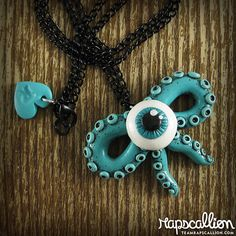 Tentacle Bow Eyeball Necklace by rapscalliondesign on Etsy, $24.00