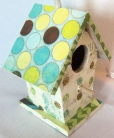 bird house decorated with scrapbook paper