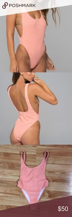 Peach textured motel one piece medium Brand new one piece with tags- textured material and very thick! Low cut in the back, and low cut on the sides! Very flattering on and true to size Motel Rocks Swim One Pieces