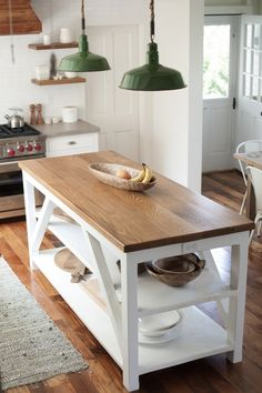 Simple kitchen island. Green Pendant Lights in a White Farmhouse Kitchen - Hannah Childs