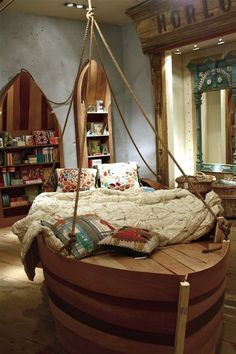 Is this the coolest or what? boat shaped bed for kids room ideas from kids Space Stuff - would need a larger house than ours though!