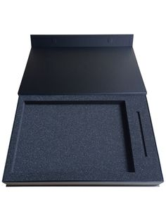 Rigid box with magnetic close with custom cut foam insert. High end luxury black matte client gift box with customised black foam insert