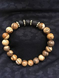 A personal favorite from my Etsy shop https://www.etsy.com/ca/listing/577955785/brown-picture-jasper-lava-rock-essential