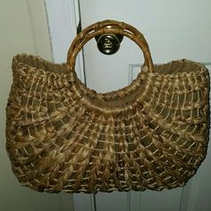 Tote The perfect accessory for those cute summer dresses! Straw tote with round, wooden handles. Make me an offer!  Bags Totes