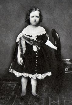 Oscar Wilde in a blue velvet dress, aged about two