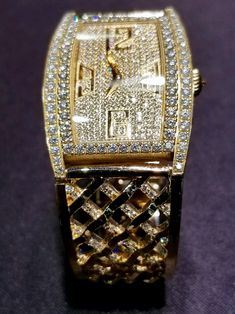 Elegance & style of a Piaget diamond watch made even more stunning by a custom Fred Nasseri designed gold bangle bracelet, intertwined with round-cut diamonds set in micro-pave style in a criss-cross pattern by master artisans at Unicorn Jewelry in Rancho Bernardo