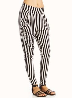 Black and white vertical striped harem pants.