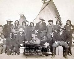 """William Frederick """"Buffalo Bill"""" Cody with a group of Indians. Buffalo Bill is shown standing in the center of the back row. It was taken in 1891 by John Grabill. Buffalo Bill is remembered as an American soldier, bison hunter, Scout and most of all, a consummate showman. His Wild West shows travelled the country entertaining throngs of people."""