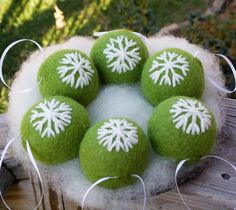 Needle Felted Christmas Ornaments Wool With Snowflakes Six. $96.00, via Etsy. Very nicely done.