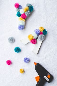 DIY Pom Pom Letters - A simple tutorial which shows how to create these pom pom monogram letters with yarn or wool.