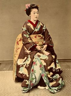 Kioto Dancing Girl by Kusakabe Kimbei 1880s. This hand-coloured albumen photograph shows a maiko (apprentice geisha) from Kyoto dressed in an elaborate dove motif kimono.