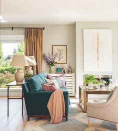cozy living room with turquoise sofa | Ana Pardo & Carla Rotaeche
