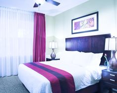 Sink into the warmth of your cozy master bed at Bluegreen Vacations The Fountains, an Ascend Resort in Orlando, FL.