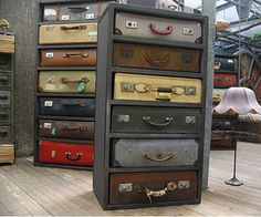 old suitcases refurbished and housed in a metal bookcase form a chest of drawers