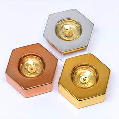 Mix and match in quirky co-ordination with this set of three hexagonal tealight holders. Ceramic with a metallic finish in three complementary shades. PartyLite 2017