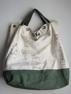 I have a repurposed mail bag and I absolutely love it.  It is definitely a conversation piece when I carry it.