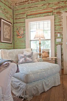 salvaged walls and a pretty pallet in this shabby room. I think I could disappear in that chaise!
