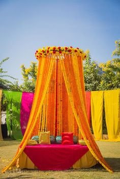 Mehendi Decor - Marigold Mehendi Decor | WedMeGood | Genda Phool Decor with Pink and Yellow Decor Detailing  #wedmegood #indianbride #indianwedding #bridal #mehendidecor #decor #diydecor #marigold