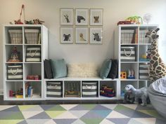 playroom. toddler room. baby animals. blue gray white gold. ikea kallax toy storage. land of nod. world market.