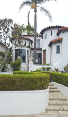 Here's a pretty little Spanish style house with great curb appeal.