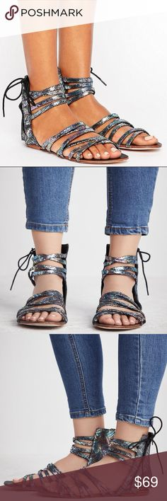Free People Iridescent Gladiator Sandal Eye-catching black iridescent gladiator sandal featuring an open, strappy design that wraps over the foot and up around the ankle with a cute side lace-up detail. Exposed back zipper closure for an easy on-off. Leather upper, lining, and sole. 5.5 inch shaft. Size 37. New in box.   NO TRADES. Free People Shoes Sandals