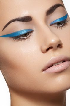 Blue eyeliner with a nude lip