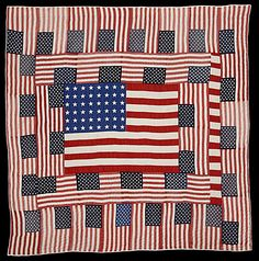 American Flag quilt by Eugenia Mitchell, 1979, Rocky Mountain Quilt Museum.  Made from discarded/salvaged bunting and flags.