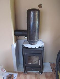 A rocket stove mass heater or rocket mass heater, is a space heating system deve… – Wood Burning Stove Wood Stove Chimney, Diy Wood Stove, Stove Fireplace, Fireplace Ideas, Outside Wood Stove, Diy Heater, Stove Heater, Pellet Stove, Fireplace Blower Insert