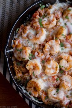 Cajun Shrimp and Quinoa Casserole. Quinoa is seasoned with cajun seasonings and fresh tomatoes, topped with shrimp and fontina cheese and baked to perfection.