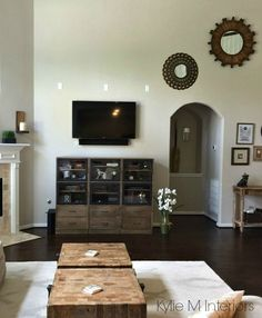 revere pewter by benjamin moore is a gray paint colour for any room. Shown in living room with tv mounted on wall and rustic feeling home decor