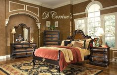Heavy brown Victorian theme bedroom. Salmon-colored bed give a soft contrast accents to the brown wall. Beautiful!