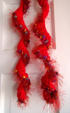 New hand-crocheted ruffle skinny scarf, worked in bright red and trimmed with multicolored novelty eyelash yarn. It spirals naturally and looks gorgeous either hanging loose or doubled and looped through. $25.00. Available in my Etsy shop: www.etsy.com/...