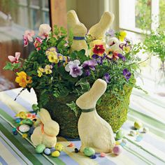 I think this from Southern Living- Easter Flowers    Decorate your Easter table with colorful blooms, candies, and bunnies. Hide the flowers' container with moss for a fresh, Spring look.