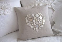 This sweet pillow measuring 12x12inches is embellished with lovely natural colored buttons. There are fish, birds, stars, leaves, flowers,