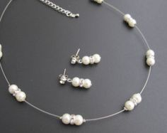 Twisted perla collar nupcial marfil perla por fashionjewelryforeve Necklace Sizes, Lariat Necklace, Pearl Bracelet, Necklace Lengths, Pearl Jewelry, Bridal Jewelry, Grape Earrings, Ring Spacer, Ivory Pearl