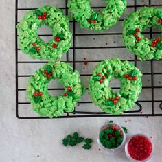 Make these cute Rice Krispie Treat Wreaths this holiday season for a simple Christmas treats! With the basic Rice Krispie treat recipe, some food coloring and decorations you can have an adorable wreath Christmas cookie. #ricekrispietreats #wreath #christmascookie #holidaybaking Rice Krispy Treats Recipe, Rice Krispie Treats, Rice Krispies, Easy Christmas Treats, Christmas Cookies, Simple Christmas, Holiday Baking, Christmas Baking, Donut Maker