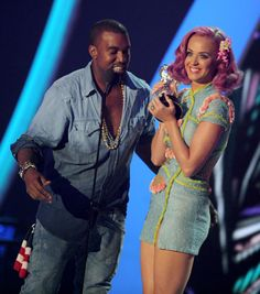 Kanye West leans in to give his thanks as Katy Perry holds up the duo's trophy for the Best Collaboration at the 2011 MTV Video Music Awards. | MTV Photo Gallery